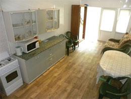 Как расширить кухню на первом этаже?